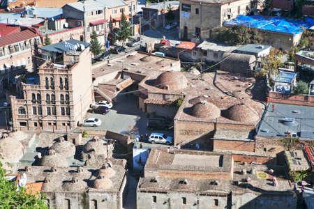 tbilisi: TBILISI, GEORGIA - November 04, 2016 : Tbilisi city center aerial view from Narikala Fortress, Georgia