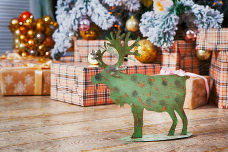Christmas Card With Golden Festive Decoration.Green Moose, Christmas Ball, Hear,  Star. Gray, Rustic, Vintage Wooden Background. Copy Space For Advertisement. Stock Photo