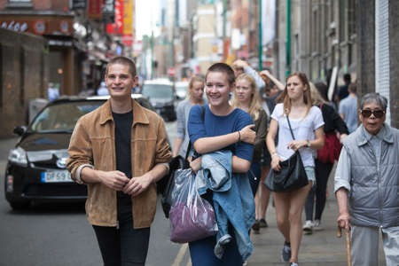sunday market: LONDON, UK - August 27, 2016: Hipsters on Brick Lane in the East End of London  Highly fashionable people on Brick Lane in the East End of London. This area of London is known for its eclectic, brilliant, sometimes bizarre fashion as young people gather  Editorial