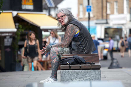 outrageous: LONDON, ENGLAND - JULY 12, 2016 Portrait of a middle age man with tattoos, in a punk outfit Editorial