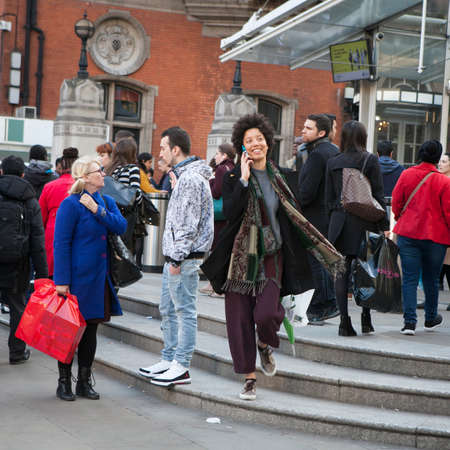 sunday market: LONDON, ENGLAND - JULY 12, 2016 A motley crowd waiting at a pedestrian crossing, intending to cross the road