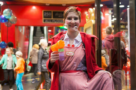regent: London, UK. 28 November 2015. A girl dressed as a festive gdall helps to entertain hundreds of people gathered in Regent Street, which has been closed for traffic, to enjoy toy