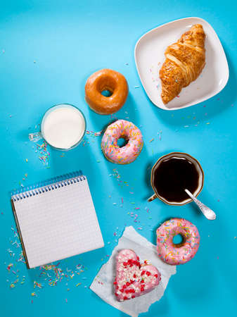 The ideal breakfast for the proper energy for the full day. Fresh coffee with milks and donuts . Hipster pictures. Top view