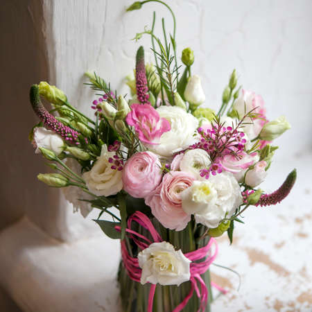 Spring bouquet of pink Ranunculus, lisianthus and Veronica for a special wedding ceremony Reklamní fotografie