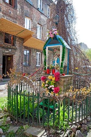 WARSAW, POLAND - MAY 01, 2017, Small shrine with Our Lady statue in Ochota district of Warsaw, Poland