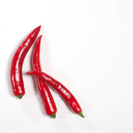 Red chili peppers isolated on white background. Postcards for recipes