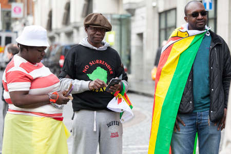 against the current: LONDON, ENGLAND - March 12, 2017 Vigil, outside Zimbabwe Embassy, take place every Saturday to protest against gross violations of human rights by current regime in Zimbabwe