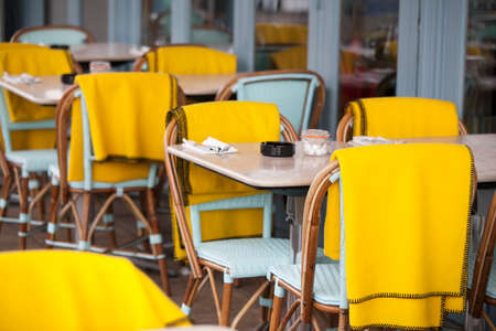 Restaurant zone with colorful plastic chairs and tables and yellow plaid in the lobby of the mall. Beautiful interior Stock Photo