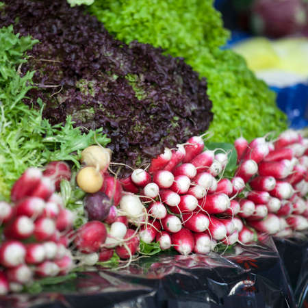 sell: Bunch of Radish and salad on the street food market in Southern France, Provence, farmers market food Stock Photo
