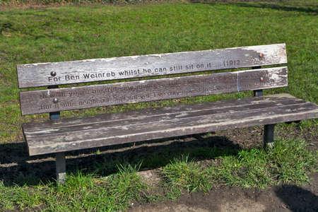LONDON, ENGLAND - JULY 12, 2016 UK. Bench dedicated to Weinreb in Hamptsead, London,