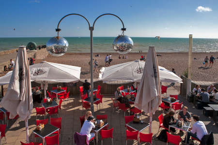Brighton, ENGLAND - JULY 12, 2016 Brighton beach reflected in a mirror ball hanging in one of the beach front cafes Editorial