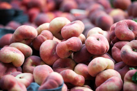 Variety of peaches on the market for sale. Peaches are a storehouse of vitamins