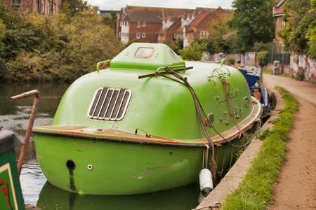 regent: LONDON, ENGLAND - August 20, 2017 Green submarine on Regent canal near Broadway market
