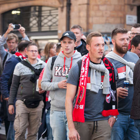 marched: LONDON, ENGLAND - September 14 2017 During the day a large crowd of Cologne fans marched through Soho and then into Oxford Street which they brought to a halt.