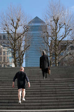 LONDON, UK - January 12 2015 - Mid Afternoon view of Canary Wharf London. People climb the stairs Editorial