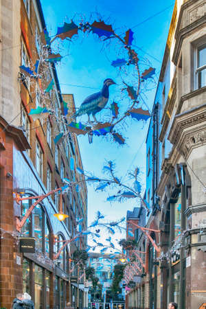 LONDON, ENGLAND - December 18 , 2017 View looking up at the Christmas lights in Slingsby Place off Long Acre in London