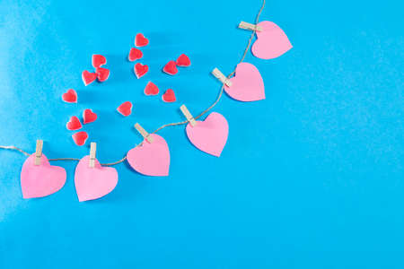 Red hearts from chewing marmalade on a blue background
