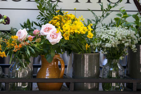 the Dahlias, roses, bell, fennel in bouquets for sale Stock Photo