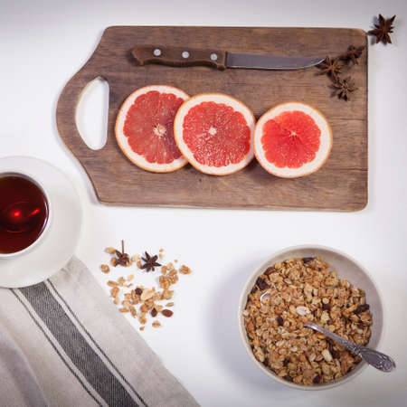 Set for mulled wine: sliced grapefruit with anise on the board on the white background.