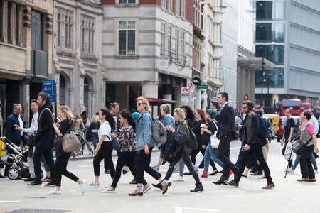 LONDON, ENGLAND - AUGUST 22, 2017 People cross the road near Liverpool Street subway.