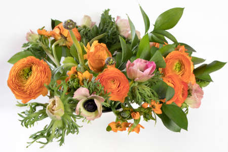 A wedding bouquet of buttercups, anemones and Ruscus on the white background