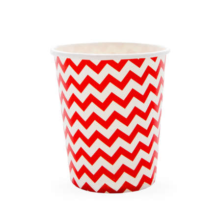 Red paper disposable glass in zigzag isolated on white with copy space