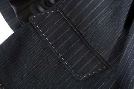 the Pocket of suit with seams. A gray jacket with a strip of good wool.