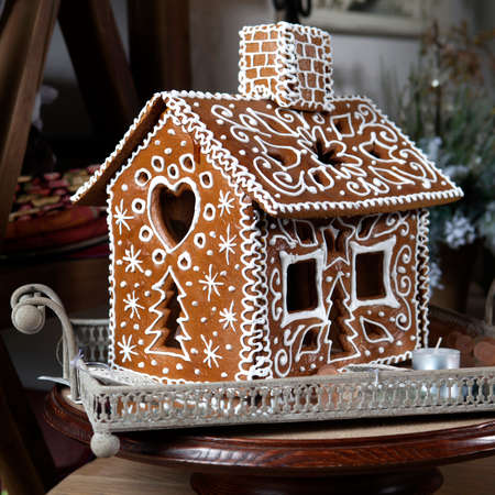 Homemade gingerbread house and christmas spices Standard-Bild