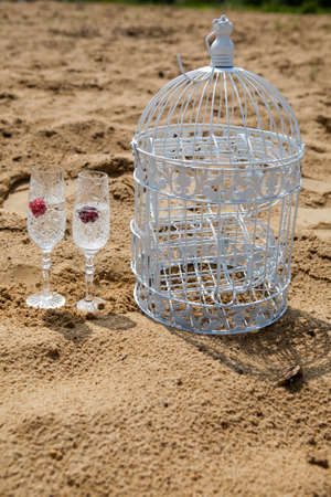 Two Glasses of champagne with cherry on the beach