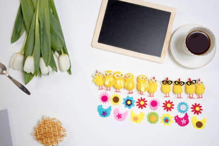 background with white tulips and funny figures of chickens and flowers from felt. Easter card