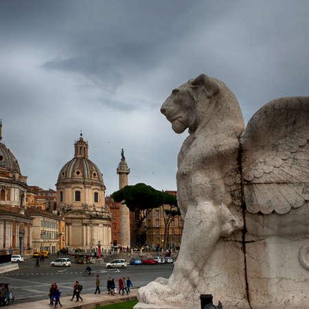 Rome, Italy - November 18, 2017 Piazza Venezia - View of Santa Maria di Loreto Church, Palazzo Valentini and Trajan Column from steps of Altare della Patria