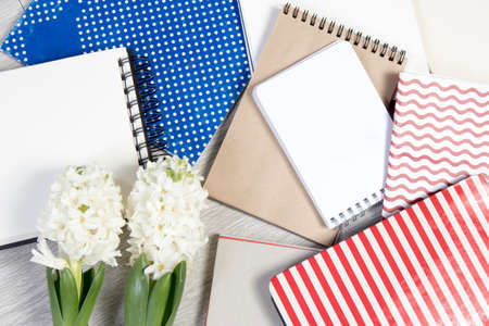 Flowers composition with white hyacinths with notebook. Spring flowers on white background. Easter concept.