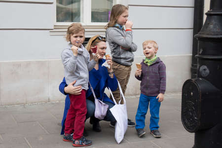 WARSAW, POLAND - April 08, 2018 People on the central street of Warsaw. Family of mother and three sisters Sajtókép