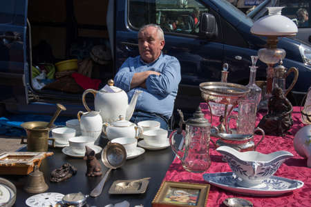 WARSAW, POLAND - April 08, 2018 Street flea market of old things and antiques in the old district Редакционное