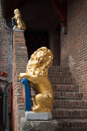 Muiden , Holland - 14 April 2018 The castle Muiderslot in the village Muiden near Amsterdam in Holland, the Netherlands, Europe. Gold Leon on the steps