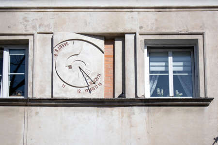 WARSAW, POLAND - APRIL 28, 2018: Ancient sundial on the external wall of building in Warsaw