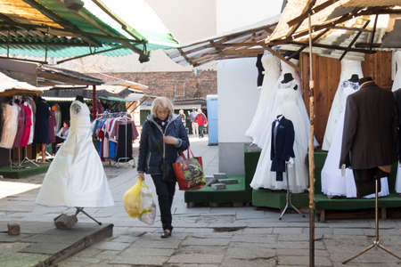 WARSAW, POLAND - MAY 01, 2018 Bazar Rozychkiego is the oldest market in the city and dates back to 1901 in district of Praga. Preparation for the First Communion