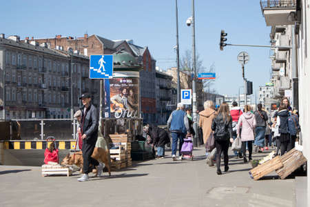 WARSAW, POLAND - APRIL 28, 2018: Street vendors sell fruit near the underground passage in the Prague area Editorial