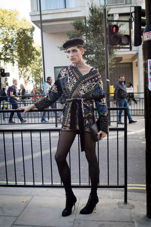 LONDON, UK- SEPTEMBER 14 2018: People on the street during the London Fashion Week. Drag queen in a dark blazer and beret