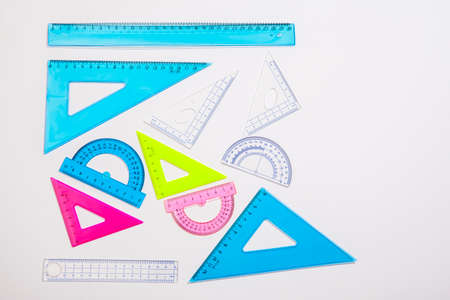 Copy space. Multicolored rulers for schoolchild on white background