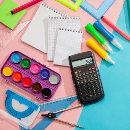 Preparation and learning of primary school children. Bright and multicolored school background with stationery accessories for the study of general subjects. Flat Lay, Copy space, place for text. Фото со стока