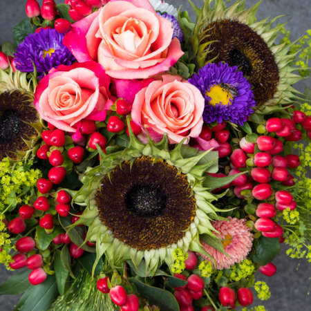Wedding bouquet of the ripe sunflower, hawthorn berries, asters and roses for sale