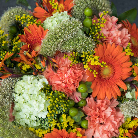 the Bridal bouquet of red carnation, allius, green hawthorn, gerbera and yellow daisies for sale