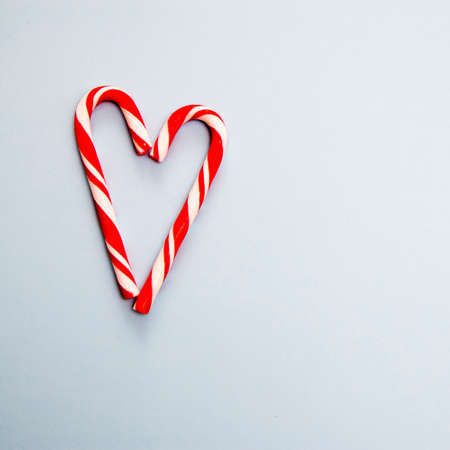 Christmas candy Magic Staff in form of heart on the blue background. Stock fotó