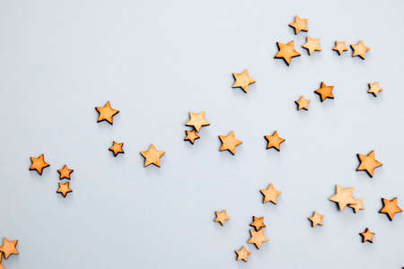 Wooden stars on a blue background as a concept of the starry sky Stock fotó