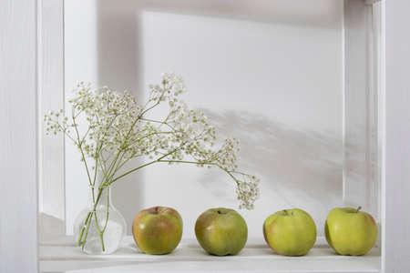 Wedding bouquet on a shelf with an apple on the shelf Stock fotó