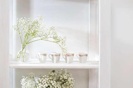 Wedding bouquet in a glass vase on a shelf