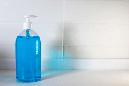 Copy space. Fragment of the interior of the kitchen. Liquid blue soap in a transparent plastic.