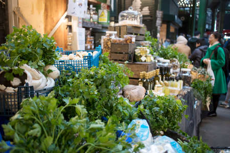 London, UK - 12 March 2020 , Selling fresh herbs and vegetables at Borough Market