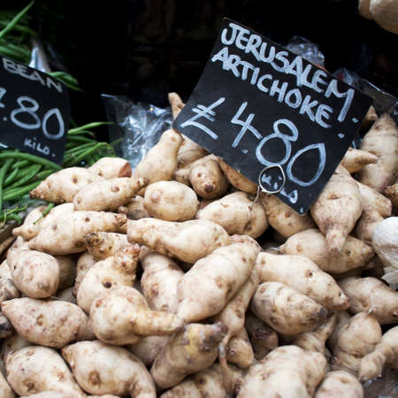 Square frame format. Jerusalem artichokes and fine bean for sale at a farmers market Reklamní fotografie